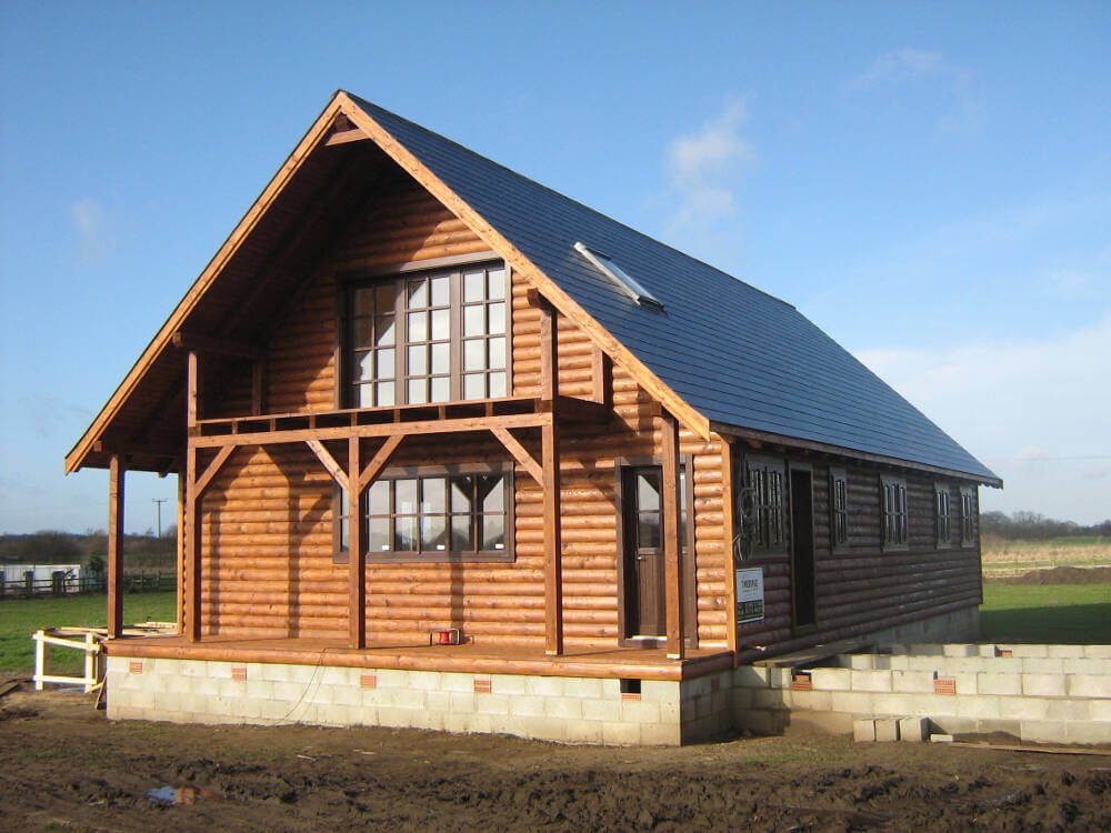 Timber frame contractors in kent timberlogbuild for Timberframe house