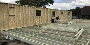 timber-log-cabin-installation-process-4-600x300